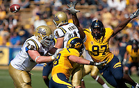 Cameron Jordan (97) pressures quarterback Kevin Prince (4). The California Golden Bears defeated the UCLA Bruins 35-7 at Memorial Stadium in Berkeley, California on October 9th, 2010.