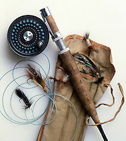 Fly-fishing still life with flies, line, rod, reel and antique case.