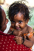 11 month old, Sita Mandal seen with her grand-daughter, Gita Devi (50) in thier house in Bhardaha in Saptari, Nepal.