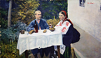 FX8H40 Postcard printed in Russia shows Man and woman in Ukrainian national clothes sitting at the table - A man gives the woman a glass of wine