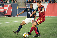 FOXBOROUGH, MA - SEPTEMBER 21: Andrew Farrell #2 of New England Revolution comes in to tackle Tate Schmitt #21 of Real Salt Lake during a game between Real Salt Lake and New England Revolution at Gillette Stadium on September 21, 2019 in Foxborough, Massachusetts.