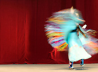 A dancer from the Red Crooked Sky Dancers American Indian dance troupe performs traditional dances before the start of the talk with the Dalai Lama Thursday at the nTelos Wireless Pavilion. Photo/Andrew Shurtleff