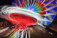 AUGUSTA, NJ - AUGUST 8: Colorfully illuminated rides spin against the night sky during the New Jersey State Fair on August 8, 2012 at the Sussex County Fairgrounds, Augusta, New Jersey.