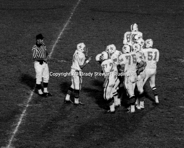 Bethel Park PA:  Offensive play with the Blackhawks huddling up before a play against the Wash High Prexies. Others in the photo; Mike Stewart 11, John Bender 27, Joe Barrett 75, Don Troup 51, Bruce Evanovich 80, Clark Miller 30, Dennis Franks 66. Bethel unveiled their new uniforms against Washington and ended up destroying the Prexies (42-12).  Two touchdowns each by Chip Huggins, Clark Miller, and Mike Stewart were the most points scored this season.