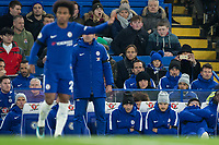 Chelsea manager Antonio Conte wife Elisabetta Muscarello holds her camera phone up early in the second half as she sits beside daughter during the Premier League match between Chelsea and Swansea City at Stamford Bridge, London, England on 29 November 2017. Photo by Andy Rowland.