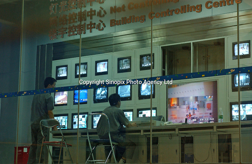 Banks of security TV's at a public complex in Shenzhen, south China. Closed circuit TV monitoring is becoming more prevalent in China..