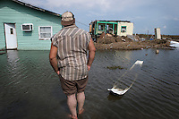 Dominic Dardar views the ruins of his house after hurricane Gustav delivered wide spread wind damage and water damage to the predominantly Native American community of Isle Jean Charles, Louisiana. The island remained without electricity and running water for weeks. Residents were under mandatory evacuation before the storm and many are relying on emergency food, ice and water supplies in the sweltering summer heat.