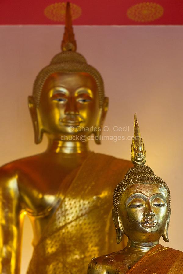 Bangkok, Thailand.  Buddha in Small Temple at Base of Wat Saket (Phu Khao Thong), the Golden Mount.