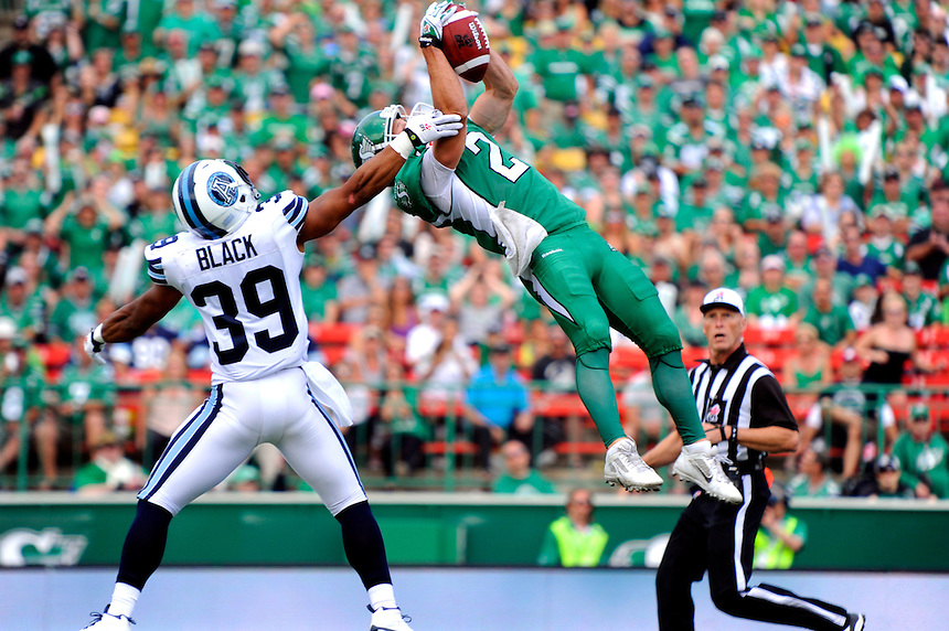 The Saskatchewan Roughriders' Ryan Smith makes an acrobatic grab against Matt Black and the Toronto Argonauts during CFL action in Regina Sunday, July 5, 2015. THE CANADIAN PRESS/Mark Taylor.
