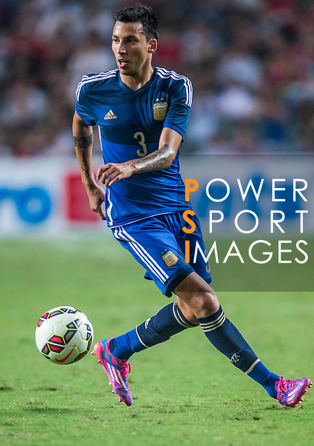 Leonel Vangioni of Argentina in action during the HKFA Centennial Celebration Match between Hong Kong vs Argentina at the Hong Kong Stadium on 14th October 2014 in Hong Kong, China. Photo by Aitor Alcalde / Power Sport Images