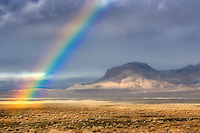Rainbow with mountains. Black Rock Desert National Conservation Area. Nevada