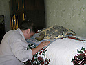 Armenia 2007  <br /> In a house, a Yezidi woman praying in a room    <br /> Armenie 2007 <br /> Dans une maison Yezidi, femme priant dans une chambre