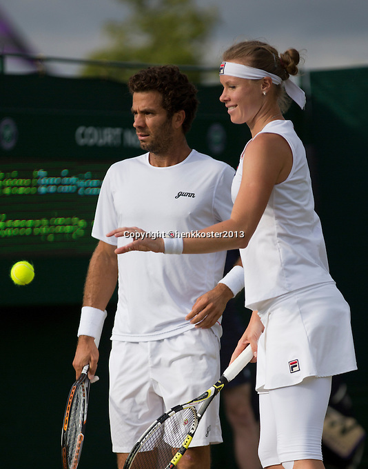 03-07-13, England, London,  AELTC, Wimbledon, Tennis, Wimbledon 2013, Day nine, Jean-Julien Rojer (NED) with dis mixed doubles partner Vera Dushevina (RUS)<br /> <br /> <br /> <br /> Photo: Henk Koster