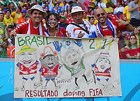 Costa Rica supporters hold a banner in relation to the recent doping tests on their side held by FIFA
