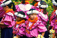 Young girls adorned with colorful flower leis perform as part of the Aloha Week festivities. These photos taken near the statue of King Kamehameha in downtown Honolulu.