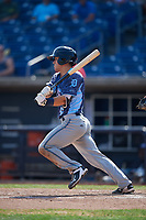 West Michigan Whitecaps catcher Brady Policelli (6) follows through on a swing during a game against the Quad Cities River Bandits on July 23, 2018 at Modern Woodmen Park in Davenport, Iowa.  Quad Cities defeated West Michigan 7-4.  (Mike Janes/Four Seam Images)