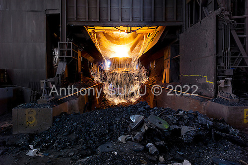 """Dearborn, Michigan<br /> USA<br /> February 15, 2011<br /> <br /> The former Ford Rouge Steel Plant completed in 1928 is now owned, run and being renovated and expanded by Russian owner """"Severstal North America"""". This is one of five steel plants owned by Severstal in the United States and they are spending huge sums to convert it into what could be the continent's most efficient automotive steel plant.<br /> <br /> Molten pig iron is transported from the blast furnace and poured in to a vat at the basic oxygen furnace. BOF is a steel making furnace, in which molten pig iron and steel scrap convert into steel due to oxidizing action of oxygen blown into the melt under a basic slag. <br /> <br /> Rouge Steel fell on hard times after Ford Motor Company spun it off in 1989 into an independent steel company. <br /> <br /> After buying the assets of the bankrupt company for USD 280 million, Severstal spent USD 350 million to repair one of the blast furnaces. The company built a new cold-rolling line which converts steel slabs into sheet metal. And it added a galvanizing line which coats sheet metal with zinc for rust-resistant body panels.<br /> <br /> The operation assets and improvements amount to USD 1.4 billion. Add in spending on a new mini mill in Columbus, Mississippi a USD 1.6 billion operation and Severstal has placed a USD 3 billion bet on North America auto industry."""