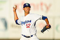 Ogden Raptors starting pitcher Carlos Frias (52) in action against the Orem Owlz at Lindquist Field on July 27, 2012 in Ogden, Utah.  The Raptors defeated the Owlz 6-3.   (Brian Westerholt/Four Seam Images)