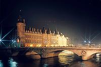 La Conciergerie and the Pont Neuf bridge over the Seine river, Paris, France.