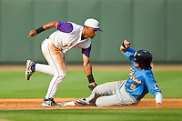 Winston-Salem Dash second baseman Micah Johnson (3) fields the throw from the catcher as Myrtle Beach Pelicans left fielder Jake Skole (9) steals second base at BB&T Ballpark on July 7, 2013 in Winston-Salem, North Carolina.  The Pelicans defeated the Dash 6-5 in 8 innings in game two of a double-header.  (Brian Westerholt/Four Seam Images)