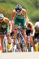 27 MAY 2012 - MADRID, ESP - Ryan Bailie (AUS) of Australia (centre, in green and yellow) on the bike during the elite men's 2012 World Triathlon Series round in Casa de Campo, Madrid, Spain .(PHOTO (C) 2012 NIGEL FARROW)