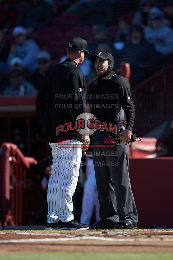 Home plate umpire Anthony Perez discusses a call with South Carolina Gamecocks head coach Mark Kingston during the game against the Holy Cross Crusaders at Founders Park on February 15, 2020 in Columbia, South Carolina. The Gamecocks defeated the Crusaders 9-4.  (Brian Westerholt/Four Seam Images)