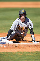 Drew Davis (16) of the Kennesaw State Owls looks up after sliding head first into third base during the game against the Winthrop Eagles at the Winthrop Ballpark on March 15, 2015 in Rock Hill, South Carolina.  The Eagles defeated the Owls 11-4.  (Brian Westerholt/Four Seam Images)