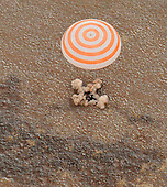 The Soyuz TMA-19 spacecraft with Expedition 25 Commander Doug Wheelock and Flight Engineers Shannon Walker and Fyodor Yurchikhin touches down near the town of Arkalyk, Kazakhstan on Friday, November 26, 2010.  Russian Cosmonaut Yurchikhin and NASA Astronauts Wheelock and Walker, are returning from six months onboard the International Space Station where they served as members of the Expedition 24 and 25 crews. .Mandatory Credit: Bill Ingalls / NASA via CNP