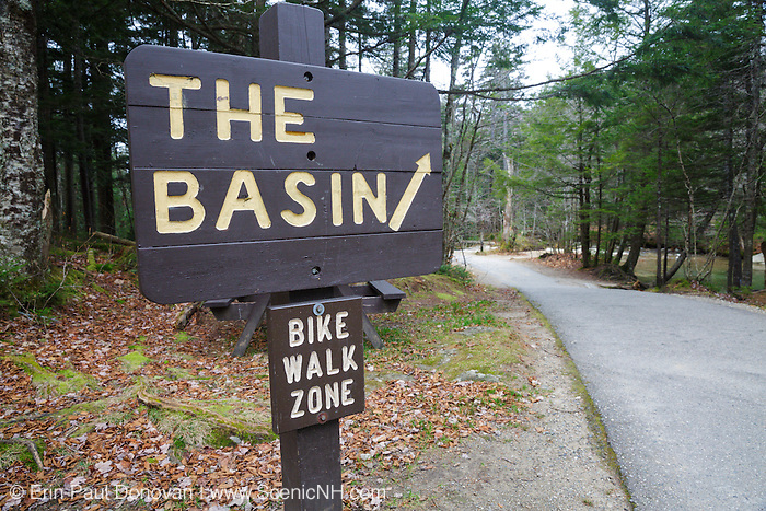 """Path to the """"The Basin"""" viewing area in Franconia Notch State Park, New Hampshire USA during the autumn months. The Pemigewasset River is in the background."""
