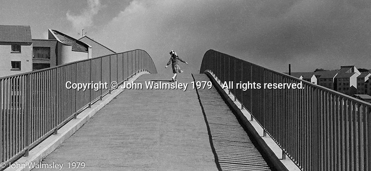 Dancing over the bridge, Wester Hailes, Scotland, 1979.  John Walmsley was Photographer in Residence at the Education Centre for three weeks in 1979.  The Education Centre was, at the time, Scotland's largest purpose built community High School open all day every day for all ages from primary to adults.  The town of Wester Hailes, a few miles to the south west of Edinburgh, was built in the early 1970s mostly of blocks of flats and high rises.