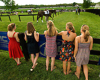 A group of female spectators during the Queen's Cup Steeplechase in Mineral Springs, NC.