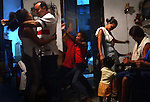 04/11/2004:  Journal photo by Ted Richardson:  A birthday party turns to late-night Salsa dancing for all ages in this central Havana home.