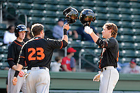 Infielder Creede Simpson (9) of the Delmarva Shorebirds, right, is congratulated by Christian Walker (23) after hitting a two-run home run in a game against the Greenville Drive on Monday, April 29, 2013, at Fluor Field at the West End in Greenville, South Carolina. Delmarva won, 6-5. (Tom Priddy/Four Seam Images)