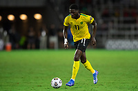 ORLANDO, FL - JULY 20: Shamar Nicholson #11 of Jamaica dribbles the ball during a game between Costa Rica and Jamaica at Exploria Stadium on July 20, 2021 in Orlando, Florida.
