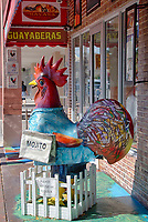 Miami, Florida.  Rooster in Front of Store Entrance on Calle Ocho, Little Havana.