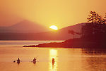 Sea kayakers, San Juan Islands, Mount Baker, Washington State, USA, Foreground: sunrise off D'Arcy Island, Gulf Islands, Haro Strait, British Columbia