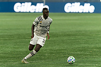 FOXBOROUGH, MA - SEPTEMBER 23: Karifa Yao #24 of Montreal Impact looks to pass during a game between Montreal Impact and New England Revolution at Gillette Stadium on September 23, 2020 in Foxborough, Massachusetts.