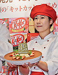 """A model holds """"Strawberry Tiramisu with Kit Kat"""" for the 45th anniversary during an event at the Kit Kat Chocolatory Ginza in Tokyo, Japan on November 14, 2018. (Photo by AFLO)"""