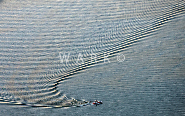 Boater on Lake Pueblo with wake. June 2014. 85028