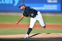 Asheville Tourists starting pitcher Alfredo Garcia (26) delivers a pitch during a game against the Columbia Fireflies at McCormick Field on June 22, 2019 in Asheville, North Carolina. The Tourists defeated the Fireflies 6-5. (Tony Farlow/Four Seam Images)