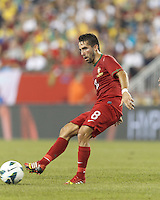 Portugal midfielder Joao Moutinho (8) passes the ball.  In an international friendly, Brazil (yellow/blue) defeated Portugal (red), 3-1, at Gillette Stadium on September 10, 2013.