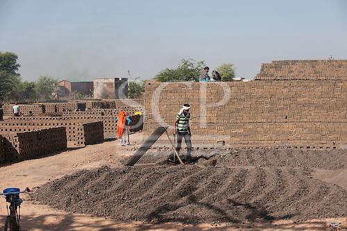 Rajasthan, India. Nr. Ranthambore National Park. Brickmaking.