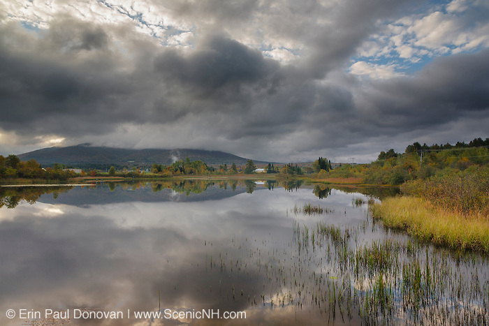 Reflection of Cherry Mountain in Airport Marsh, near Mt Washington Regional Airport, in Whitefield, New Hampshire a cloudy morning.
