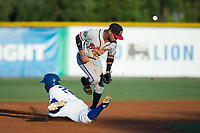 Derian Cruz (7) of the Danville Braves can't handle a throw as Seuly Matias (25) of the Burlington Royals dives back into second base at Burlington Athletic Stadium on August 12, 2017 in Burlington, North Carolina.  The Braves defeated the Royals 5-3.  (Brian Westerholt/Four Seam Images)