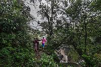 November 20, 2014.<br /> Varias mujer mayas observan la cascada del río Cambalan donde la empresa española Ecoener pretende hacer una hidroeléctrica, en Santa Cruz de Barillas (Guatemala).<br />   La llegada de algunas compañías extranjeras a América Latina ha provocado abusos a los derechos de las poblaciones indígenas y represión a su defensa del medio ambiente. En Santa Cruz de Barillas, Guatemala, el proyecto de la hidroeléctrica española Ecoener ha desatado crímenes, violentos disturbios, la declaración del estado de sitio por parte del ejército y la encarcelación de una decena de activistas contrarios a los planes de la empresa. Un grupo de indígenas mayas, en su mayoría mujeres, mantiene cortado un camino y ha instalado un campamento de resistencia para que las máquinas de la empresa no puedan entrar a trabajar. La persecución ha provocado además que algunos ecologistas, con órdenes de busca y captura, hayan tenido que esconderse durante meses en la selva guatemalteca.<br /> <br /> En Cobán, también en Guatemala, la hidroeléctrica Renace se ha instalado con amenazas a la población y falsas promesas de desarrollo para la zona. Como en Santa Cruz de Barillas, el proyecto ha dividido y provocado enfrentamientos entre la población. La empresa ha cortado el acceso al río para miles de personas y no ha respetado la estrecha relación de los indígenas mayas con la naturaleza. © Calamar2/Pedro ARMESTRE<br /> <br /> The arrival of some foreign companies to Latin America has provoked abuses of the rights of indigenous peoples and repression of their defense of the environment. In Santa Cruz de Barillas, Guatemala, the project of the Spanish hydroelectric Ecoener has caused murders, violent riots, the declaration of a state of siege by the army and the imprisonment of a dozen activists opposed to the project . <br /> A group of Mayan Indians, mostly women, has cut a path and has installed a resistance camp to prevent the enter of the company's machines. The prosecution h