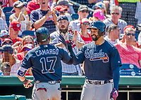 9 July 2017: Atlanta Braves outfielder Matt Kemp greets Johan Camargo after Camargo hits a solo home run in the 6th inning against the Washington Nationals at Nationals Park in Washington, DC. The Nationals defeated the Braves to split their 4-game series. Mandatory Credit: Ed Wolfstein Photo *** RAW (NEF) Image File Available ***
