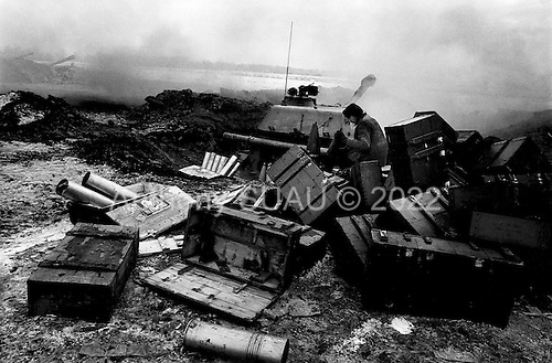 Grozny, Chechyna.January 1995.A Russian tank fires 155mm rounds at the Chechen positions in the southern part of the city from their implacements near the grozny airport. They are one of dozens of tank units firing every three minutes into the city.