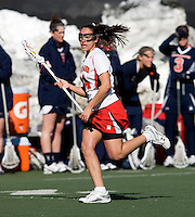 Iliana Sanza (14) of Maryland sprints upfield at the practice turf field in College Park, Maryland.  Maryland defeated Richmond, 17-7.