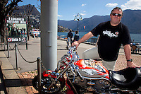 Switzerland. Canton Ticino. Lugano. Election day. Claudio Schmidt (50) with his Harley Davidson on the lake side. He has voted for Marco Borradori as new mayor. The Lega dei Ticinesi (League of Ticino) emerged triumphant from municipal elections in Lugano with three of its candidates winning election to the seven-person administrative council. 14.04.13. © 2013 Didier Ruef