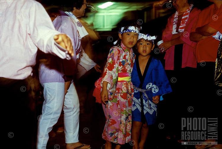 Children wearing traditional clothing (one has kimono) at Bon Dance Festival at Hongwanji Temple in Kealakekua, Kona, Hawaii.
